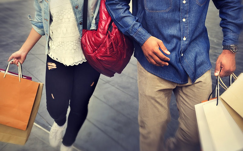 Couple walking and holding shopping bags